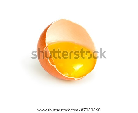 half of broken egg isolated on white - stock photo