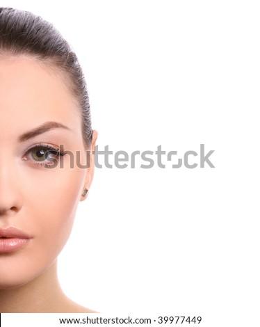 half of female face isolated on white background - stock photo