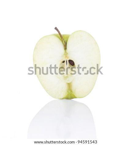 half of green apple on white background - stock photo