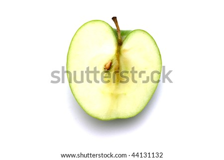 Half of juicy green apple isolated on a white background.