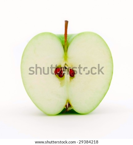 Half of juicy green apple on a white background - stock photo