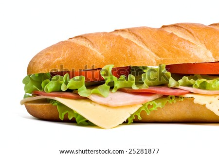 half of long baguette sandwich with lettuce, tomatoes, beef, ham, turkey breast and cheese - stock photo