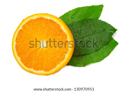Half of orange and three leaf on a white background. Top view - stock photo