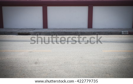 Half of street with white wall - stock photo