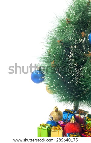 half of the Christmas tree and gifts on a white background - stock photo