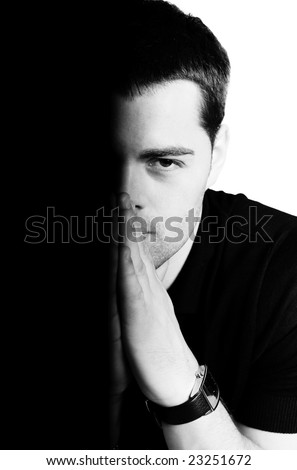 Half of young man's face isolated on white - stock photo
