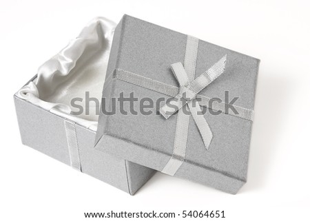 half open silver box with top leaning against the bottom; white background - stock photo