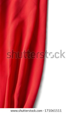 Half opened red silk curtain on white background - stock photo