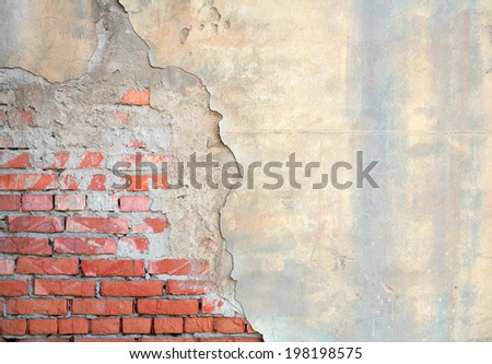 Half painted brick wall  - stock photo