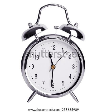 Half past eleven on a round alarm clock - stock photo