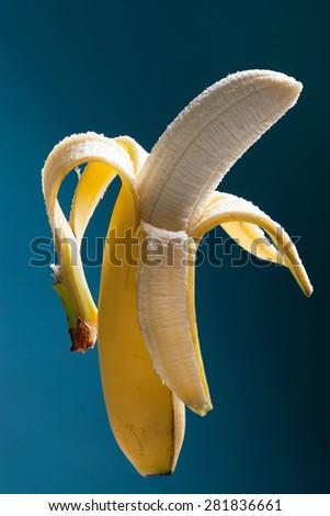 Half peeled banana - stock photo