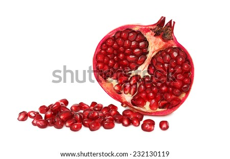 Half pomegranate with seeds isolated on white background - stock photo