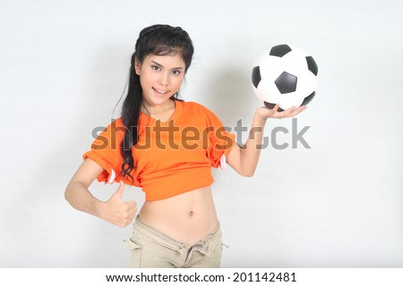 Half Portrait Beautiful woman hold ball over her head with wearing football top - stock photo