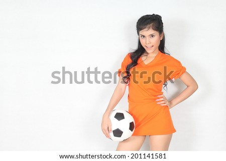 Half Portrait Beautiful woman hold ball with wearing football top - stock photo