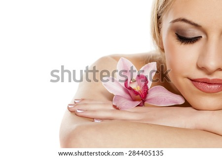 half portrait of a beautiful young woman with orchid