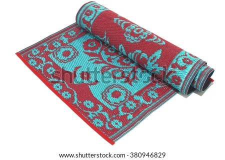 Half rolled decorative mat on white background - stock photo