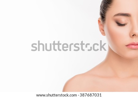 Half-side portrait of beautiful calm girl with closed eyes - stock photo