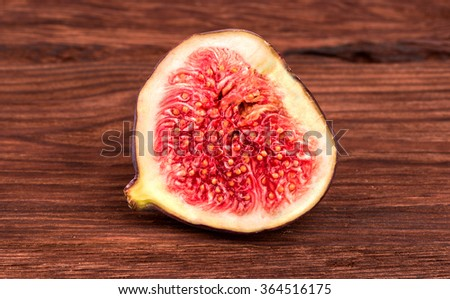 Half sliced fresh figs on a wooden background