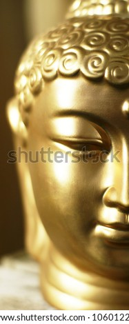 Half the head of a golden buddha in a warm (atmo)sphere.