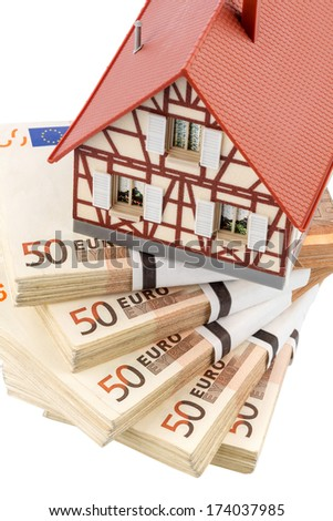 half-timbered house on euro banknotes, symbolic photo for home purchase, financing, building society - stock photo