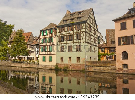 Half-timbered houses on the river bank in Strasbourg, France - stock photo