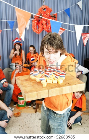 Half time snacks being brought to sports fans, watching a game at home - stock photo