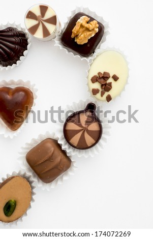 Half valentine heart made of delicious chocolate pralines. - stock photo