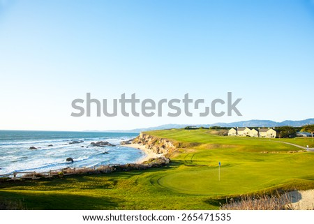 Halfmoon Bay California.  Golf course putting green and cliffs by the pacific ocean bay.  Villas and houses. - stock photo