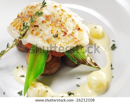 Halibut on Vegetable with Sauce - stock photo