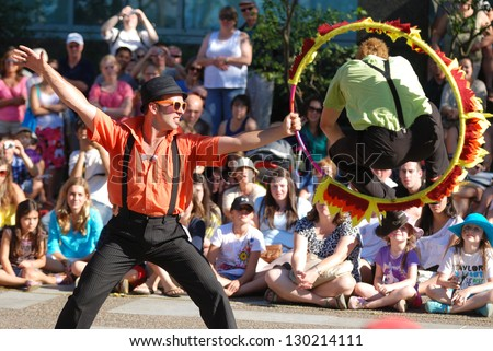 HALIFAX, CANADA - AUGUST 12: A pair of street buskers perform during the annual  summer Busker festival in Halifax Nova Scotia on August 12, 2011.