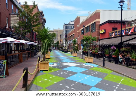 Halifax, Canada - August 3, 2015:  Argyle Street in Halifax, Nova Scotia, famous for its trendy bars and restaurants, with a new Argyle paint job on the section that has been closed to traffic. - stock photo