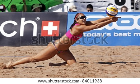 HALIFAX, CANADA - SEPTEMBER 3: Canada's Victoria Altomare reaches for the ball at the FIVB Beach Volleyball Swatch Junior World Championships on Sept. 3, 2011 in Halifax, Canada. - stock photo