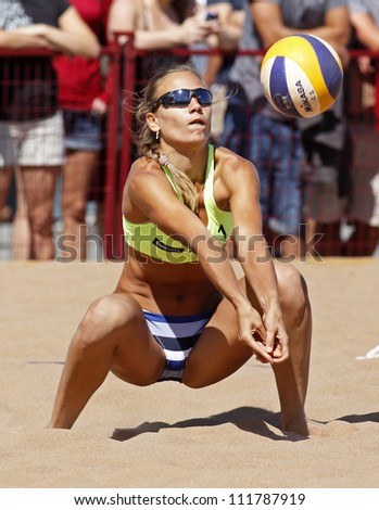 HALIFAX, CANADA - SEPTEMBER 1: Ekaterina Karapischenko of Russia competes at the FIVB Beach Volleyball SWATCH Junior World Championships on Sept. 1, 2012 in Halifax, Canada. - stock photo