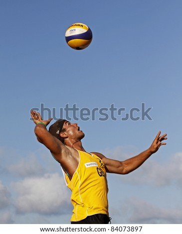 HALIFAX, CANADA - SEPTEMBER 2: Henry Glockner of Germany serves at the FIVB Beach Volleyball Swatch Junior World Championships on Sept. 2, 2011 in Halifax, Canada. - stock photo