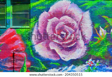 HALIFAX NOVA SCOTIA CANADA JUNE 3 Mural roses downtown Halifax on june 03 2014 in Halifax canada. One of the best ways to deter vandals from applying graffiti is to strategically place murals in areas - stock photo