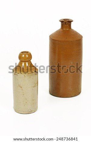HALIFAX, UK - JANUARY 31, 2015: Victorian stoneware bottle. Stoneware is a vitreous  ceramic made primarily from stoneware clay or non-refractory fire clay and is fired at high temperatures.  - stock photo