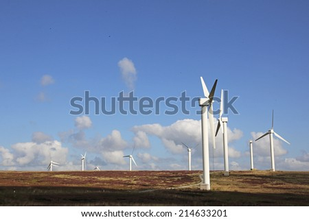 HALIFAX, WEST YORKSHIRE - SEPTEMBER 1, 2014: The 23 turbines of Ovenden Moor wind farm are supplying sustainable clean, green power and have now been doing for over 15 years.  - stock photo