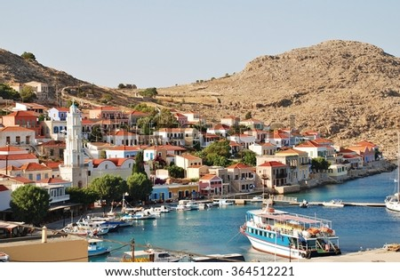 HALKI, GREECE - JUNE 16, 2015: Looking down onto the village of Emborio on the Greek island of Halki. The small island near Rhodes has a permanent population of less than 300 people.