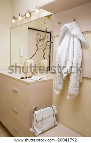 Hall furniture set with white handbag and jacket - stock photo