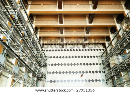 Hall in modern office building with lifts - stock photo