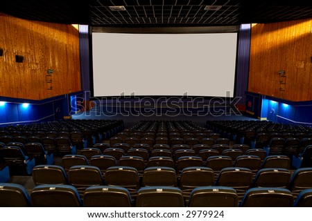 Hall of a cinema and lines of blue armchairs - stock photo
