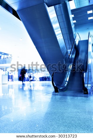 Hall of modern building and people in motion blur - stock photo