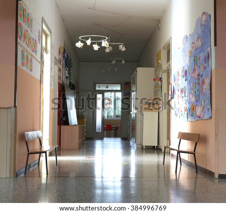 hall of the kindergarten with drawings on the walls