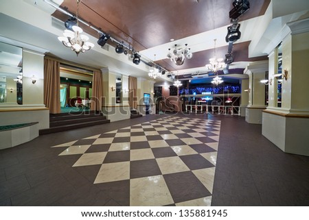 Hall with checkered floor in restaurant - stock photo