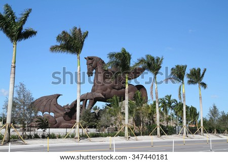 HALLANDALE BEACH, FL, USA - November 28, 2015: Recently completed attraction, at a cost of over 30 million, a giant bronze Pegasus statue slaying a dragon at Gulfstream Park Racing & Casino.