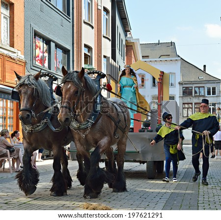 HALLE, BELGIUM-JUNE 8, 2014: Historical reconstructors on streets of historical center of the city during Mariaprocessie. This is the yearly procession in honor of Mary and Black Madonna of Halle.