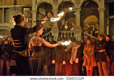 HALLE, BELGIUM-NOVEMBER 29, 2014: Artistic group shows dances with fire on Central Square in Halle, Belgium