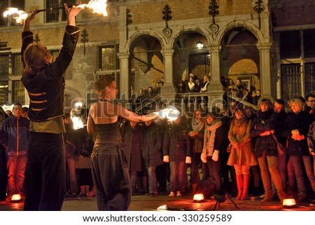 HALLE, BELGIUM-NOVEMBER 29, 2014: Artistic group shows dances with fire on Central Square in Halle, Belgium - stock photo