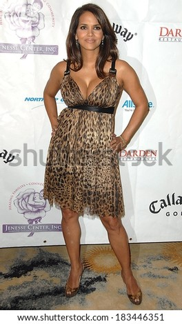 Halle Berry, wearing a Dolce & Gabbana dress, at Jenesse Silver Rose Gala & Auction, Beverly Hills Hotel, Beverly Hills, CA, April 27, 2008 Photo by David Longendyke/Everett Collection - stock photo