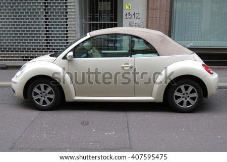 HALLE (SAALE), GERMANY - CIRCA MARCH 2016: off white Volkswagen New Beetle cabrio car parked in a street of the city centre - stock photo